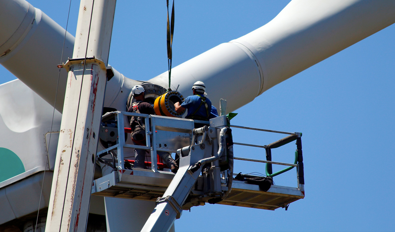 workers on a wind turbine